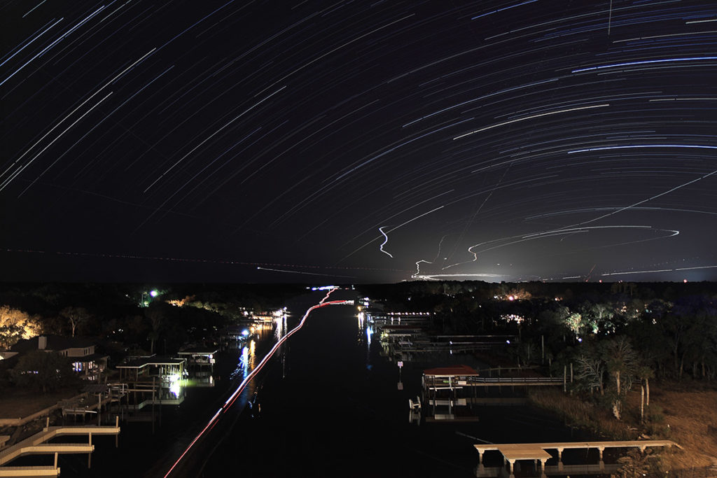 star trails over an airport